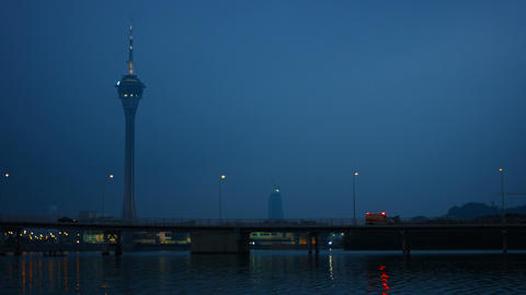 Traffic Crossing a Busy Bridge at Dusk under the Macau Tower Footage
