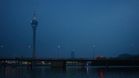 Traffic Crossing a Busy Bridge at Dusk under the Macau Tower Footage