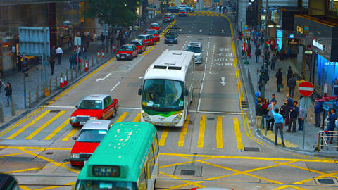 urban vehicle and pedestrian traffic at a downtown. Hong Kong GIF