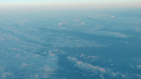 Peaceful view of fluffy clouds from an airborne perspective Footage