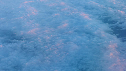 Airborne shot of a layer of puffy. pink cottony clouds Footage
