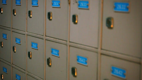 Row of identical. gray painted old post office boxes with neatly printed numbers Footage