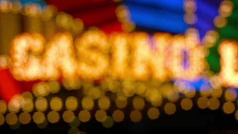 Bokeh effect from this slightly unfocused shot of a casino's flashy. brightly co Footage