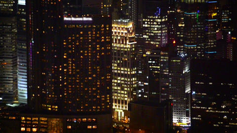 Dramatic Nighttime Cityscape with Brightly Lit Highrise Buildings Footage