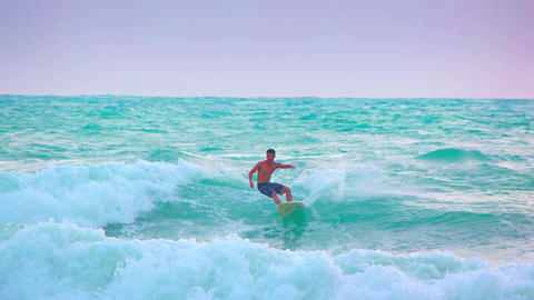 Funny. shot of a surfer standing up on his board. Thailand Footage