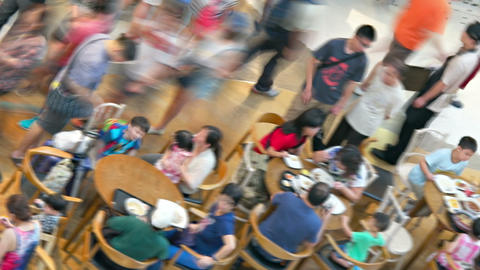 Blurry. abstract shot of diners enjoying a meal in the food court Footage