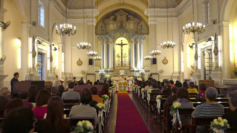 Wedding ceremony inside St. Anthony of Padua Church in downtown Macau Footage
