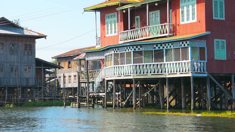 Town with large buildings constructed entirely on stilts over the water Footage