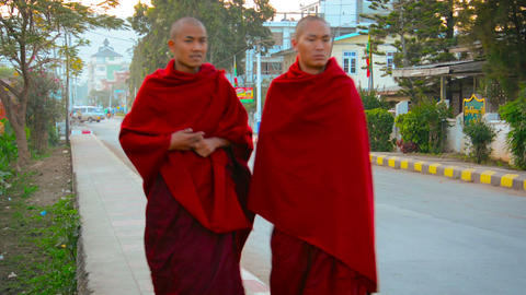 Two Buddhist monks in their traditional robes in Nyaung Shwe. Myanmar Footage