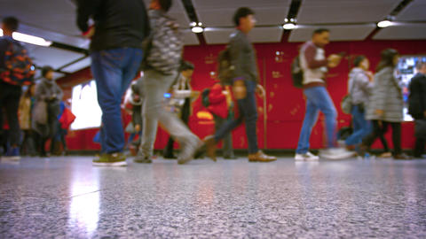Feet and people move in both directions in MRT subway in rush hours Footage