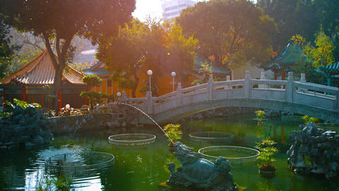 Chinese style park with ponds. bridge and fountains in Wong Tai Sin Temple Footage