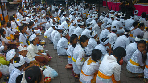 Balinese children. dressed in white clothes waiting for ceremony Footage