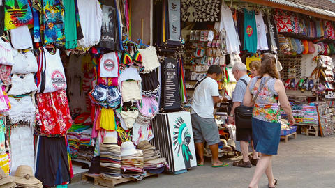 Tourists shopping at roadside souvenir stalls in the town of Kuta. Bali. Indones Footage