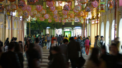 Big crowd of tourists strolling around downtown Macau at night Live Action