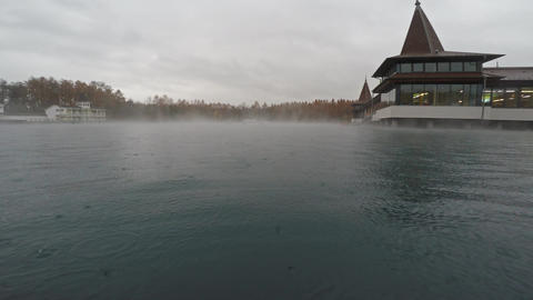 Thermal lake with rising steam and rain Live Action