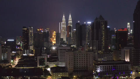Aerial view of Kuala Lumpur skyline and calm urban landscape sleeping at night in slow motion, Live Action