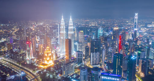 Aerial hyper-lapse of Kuala Lumpur skyline and an urban landscape at night, Malaysia Live Action