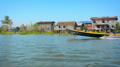 Small city with many large buildings built on stilts over the water Footage