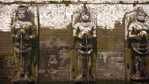 Ancient Stone Fountain Sculptures at Tirta Empul Hindu Temple. Bali. Indonesia Footage