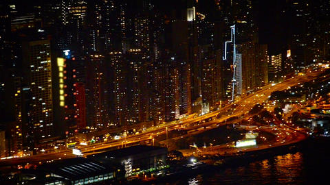 Nighttime Cityscape with Towers. a Major Highway and a Harbor Footage