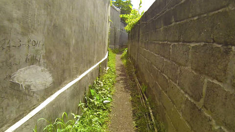Abstract Timelapse Clip of Passage along a Narrow Rural Alleyway Footage