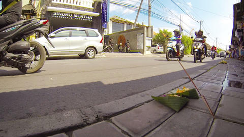 Buddhist offerings. presented on the curb in front of local businesses Footage