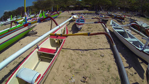 Outrigger boats and canoes. standing by on ground in Bali. Indonesia Footage