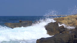 Sideview of great waves splashing at the shore, realtime in 4k Footage