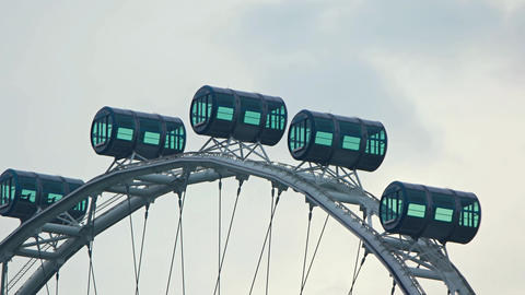 Contemporary Ferris Wheel with Cylindrical Passenger Compartments Footage