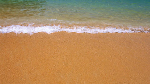 Closeup of Gentle Waves on a Tropical Beach Footage