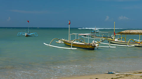 Motorized Outrigger Canoes Tied on a Tropical Beach Footage