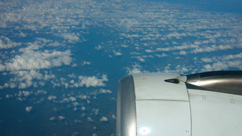 Airborne Perspective of Altocumulus Clouds over the Ocean. with Jet Engine Footage