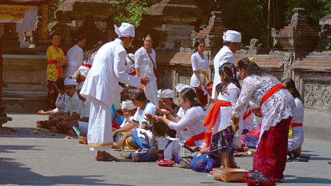 Hindus praying and worshipping at Tirta Empul water temple in Bali. Indonesia Footage