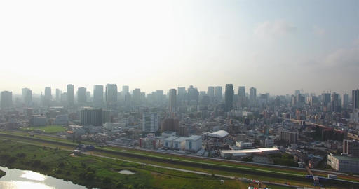 Amazing aerial view of Osaka city Skyline over yodogawa river Footage