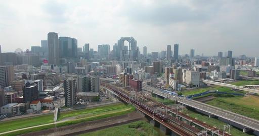Decending aerial view of Osaka city train transport into CBD Footage