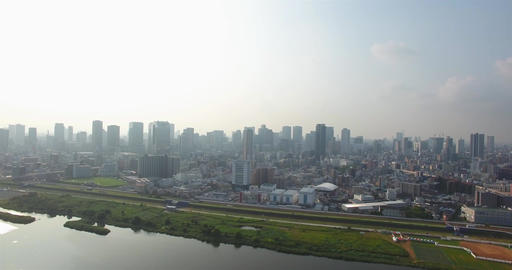 Revealing shot of Osaka City Skyline large metropolitan area aerial shot Footage