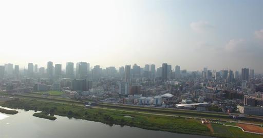 Revealing shot of Osaka City Skyline large metropolitan area aerial shot Live Action