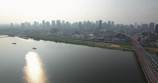 Wide angle aerial view of Yodogawa river and Osaka city Skyline 5th largest metr Footage