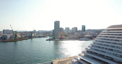 Spinning aerial reveal shot of KObe city Japan Travel destination cruise ships Live Action