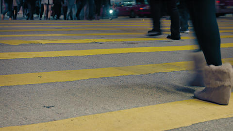 Legs and Feet of Pedestrians Crossing a Busy Urban Street Footage