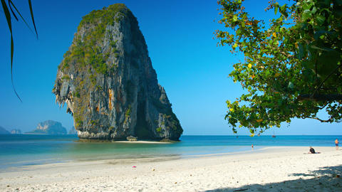 Massive Limestone Formation Towers over Tropical Beach Paradise. Thailand Footage