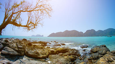 Gentle Waves on a Rocky Tropical Beach on a Sunny Day Footage