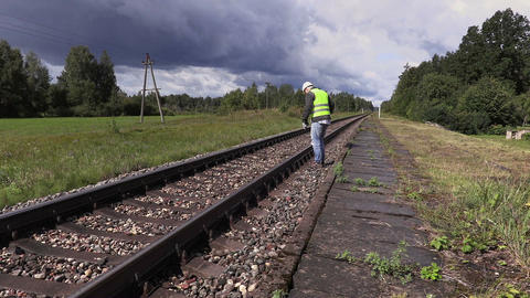 Railroad worker walking and checking railway Live Action