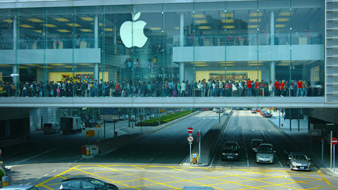 Long line of customers. waiting to enter a huge Apple store in Hong Kong Footage