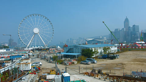 Giant Ferris wheel and other amusement rides at a carnival in Hong Kong Footage