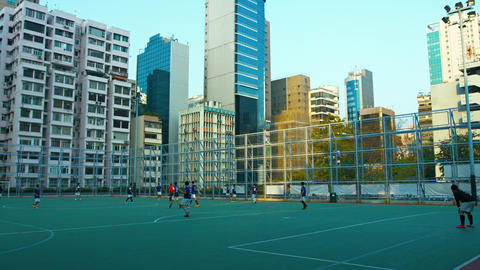 Football game on an urban field in the late afternoon. in Hong Kong. China Live Action