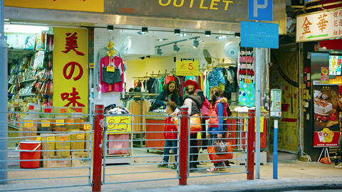Shoppers browsing through merchandise at a clothing store in Hong Kong Footage