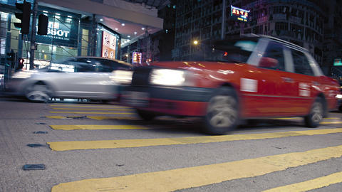 Heavy night time traffic at a major. urban intersection in Hong Kong. at night Live Action