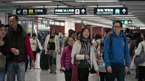Crowds of commuters. walking through subway station in Hong Kong. China Footage
