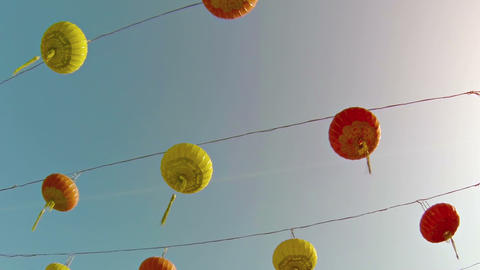 Traditional Yellow and Red Chinese Paper Lanterns outside a Buddhist Temple Footage